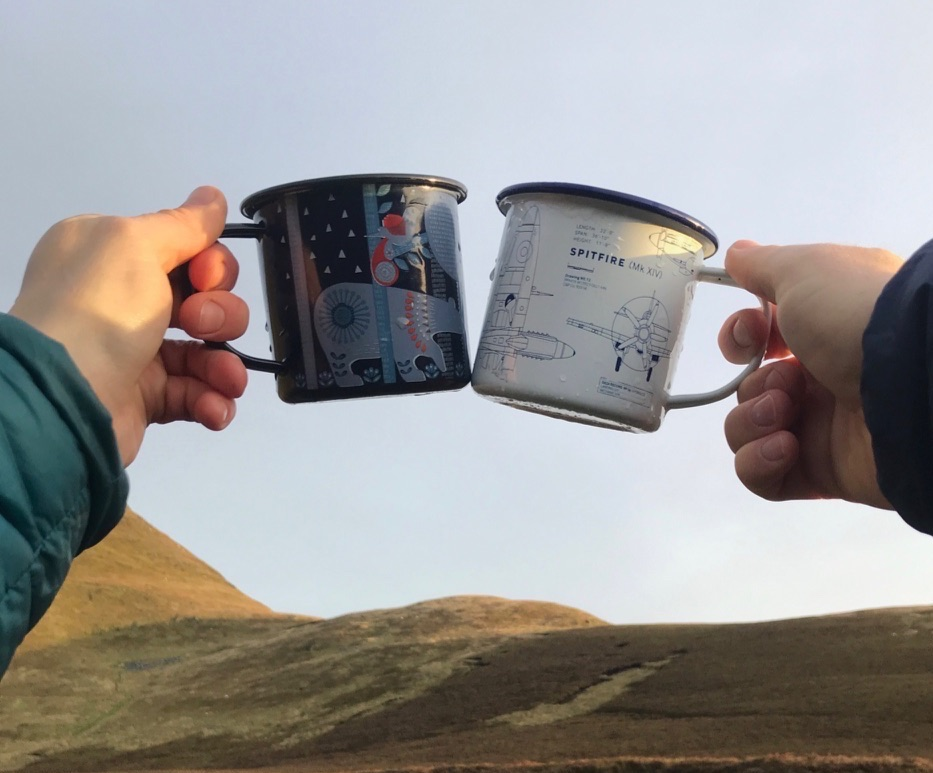 Tin cup toast in the Berwyn Mountains