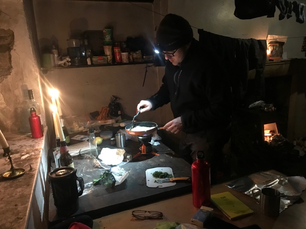 Cooking by candlelight in Nant Syddion Bothy